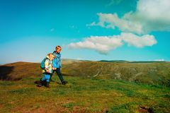 Little boy and girl travel hiking in mountains. Little boy and girl travel in mountains, family hiking in nature royalty free stock photography
