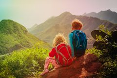 Little boy and girl travel in mountains. Family hiking in nature Royalty Free Stock Photography