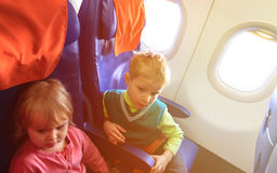 Little boy and girl travel by plane. Kids travel Royalty Free Stock Image