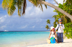 Little boy and girl travel on summer tropical beach Royalty Free Stock Photo