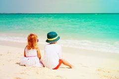Little boy and girl on tropical beach vacation. Family at beach stock image