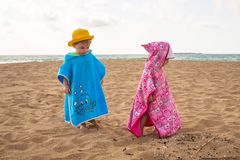 Little boy and girl twins walking on the beach of Crete. Greece royalty free stock photo