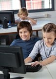 Little Boy And Girl Using Desktop Pc Stock Image