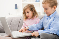 Little boy and girl using laptop Royalty Free Stock Images