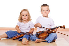 Little boy and girl with violins Stock Image