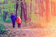 Little boy and girl walk in autumn forest Royalty Free Stock Photography