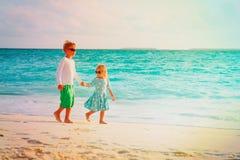 Little boy and girl walk on summer beach. Little boy and girl walk on summer tropical beach Royalty Free Stock Photography