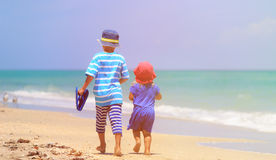 Little boy and girl walking on beach Royalty Free Stock Photo