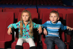 Little boy and girl watching a movie Royalty Free Stock Image