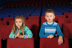 Little boy and girl watching a movie Stock Photo