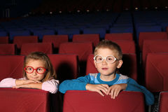 Little boy and girl watching a movie Stock Photos
