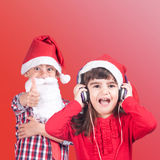 Little boy and girl wearing a Santa hat Royalty Free Stock Photo