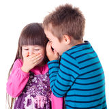 Little boy and girl whispering stock photography