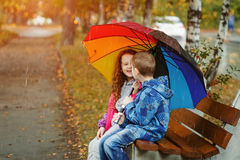 Little boy and girl whispers Stock Images