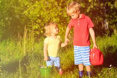 Little boy and girl working in the garden Stock Photos