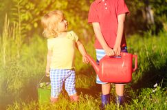Little boy and girl working in the garden Royalty Free Stock Image