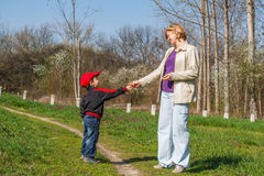 Little boy give dandelion to mother Royalty Free Stock Photography