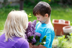 Little boy give lilac to mom mother's day Stock Image