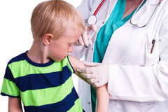 Little boy is given an injection by the family doctor Royalty Free Stock Images