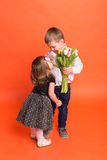 Little boy gives a girl a bouquet of flowers Stock Photography