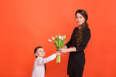 Little boy gives a girl a bouquet of flowers Stock Photos