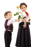 Little boy gives a girl a yellow rose Stock Photography