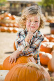 Little Boy Gives Thumbs Up at Pumpkin Patch. Adorable Little Boy Leaning on Pumpkin Gives a Thumbs Up in a Rustic Ranch Setting at the Pumpkin Patch stock image