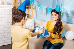 Little boy giving birthday present to his mother Royalty Free Stock Photos