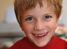 Little boy giving cheeky smile. Close-up portrait of little boy Royalty Free Stock Photos