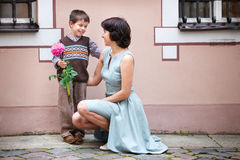 Little boy giving flower to his mom Royalty Free Stock Photography