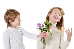 Little boy giving flowers to the girl. Isolated on white background Royalty Free Stock Photography