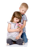 Little boy giving flowers to girl. isolated on white background.  Royalty Free Stock Images