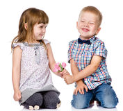 Little boy giving flowers to girl. isolated on white background Royalty Free Stock Images