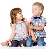 Little boy giving flowers to girl. isolated on white background.  Royalty Free Stock Photo