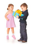 Little boy  giving a gift box to her girlfriend Stock Photos