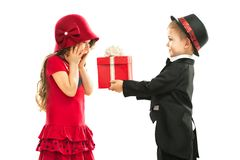 Little boy giving girl gift and his excited Stock Image