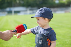 Little boy giving a interview after the match Stock Photo