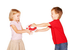 Little boy giving a little girl a gift. Present for a birthday, valentine's day or other holiday, ready for your textor symbols.. Isolated on white background Stock Photo