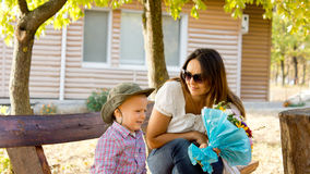 Little boy giving Mum a bouquet of flowers Royalty Free Stock Image