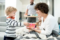 Little Boy Giving Presents to Parents stock photography