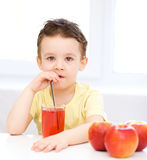 Little boy with glass of apple juice Stock Photo