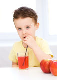 Little boy with glass of apple juice Royalty Free Stock Photos