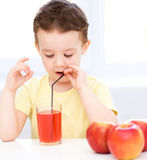 Little boy with glass of apple juice Royalty Free Stock Photography