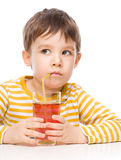 Little boy with glass of apple juice Royalty Free Stock Image