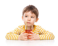 Little boy with glass of apple juice Stock Photos