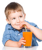 Little boy with glass of carrot juice Royalty Free Stock Photo