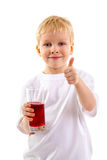 Little boy with a glass of juice Royalty Free Stock Image