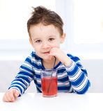 Little boy with glass of juice Stock Photo