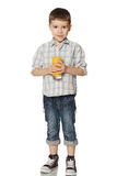 Little boy with a glass of juice licked. Royalty Free Stock Photos