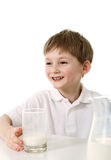 Little boy with glass of milk Royalty Free Stock Photos